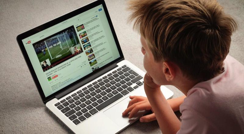 Boy Watch YouTube on Laptop | Photo