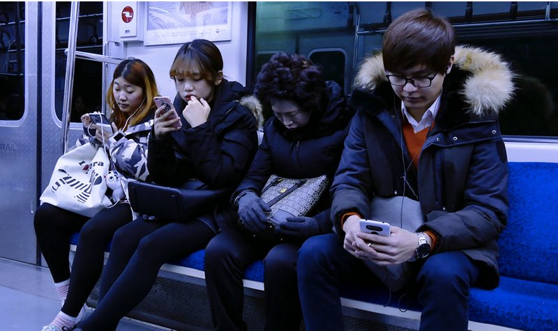 Asian Mobile Phone User | Photo
